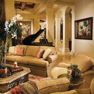 マイアミの広い地中海スタイルのおしゃれな独立型リビング (フォーマル、ベージュの壁、トラバーチンの床、両方向型暖炉、タイルの暖炉まわり、テレビなし) の写真