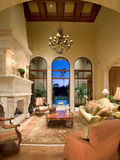 Large tuscan living room photo in Miami with beige walls
