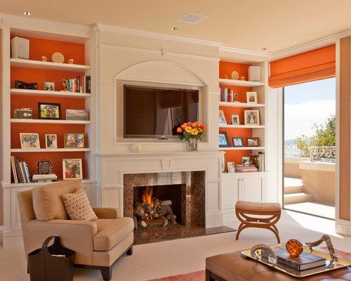 salon avec un manteau de chemin e en pierre et un mur orange photos et id es d co de salons. Black Bedroom Furniture Sets. Home Design Ideas