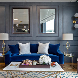 Inspiration for a classic formal living room in London with blue walls and medium hardwood flooring.