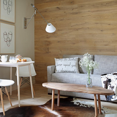 Inspiration for a mid-sized scandinavian formal and open concept light wood floor living room remodel in Other with beige walls, no fireplace and no tv