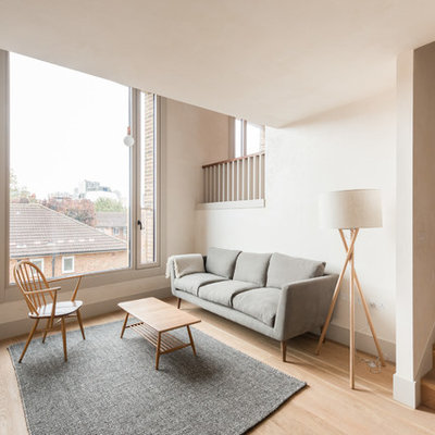 Living room - small scandinavian formal and open concept light wood floor living room idea in London with white walls, no fireplace and no tv