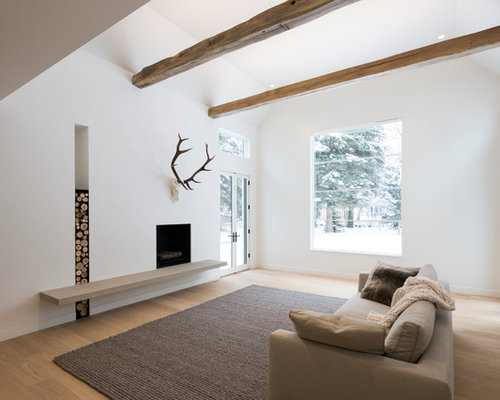 Danish formal light wood floor living room photo in Salt Lake City with  white walls and