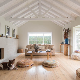 Mid-sized danish formal and open concept light wood floor and brown floor living room photo in Los Angeles with a standard fireplace, no tv, white walls and a concrete fireplace