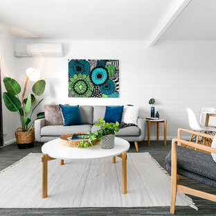 Photo of a scandinavian formal open concept living room in Hobart with white walls, carpet and grey floor.
