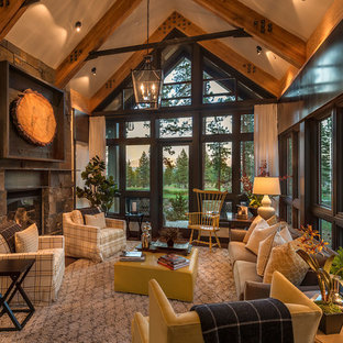 Mid-sized mountain style formal and open concept medium tone wood floor living room photo in Sacramento with beige walls, a standard fireplace, a stone fireplace and no tv