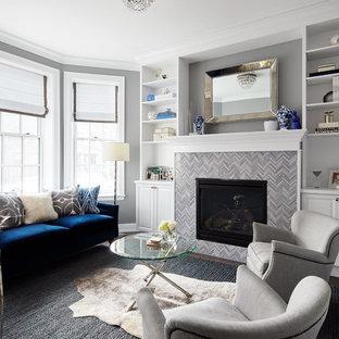 Foto de salón abierto, clásico renovado, de tamaño medio, sin televisor, con paredes grises, chimenea tradicional, marco de chimenea de baldosas y/o azulejos, suelo de madera oscura y suelo marrón