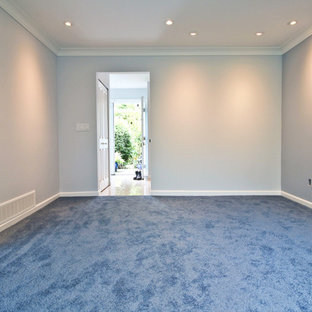 Mid-sized traditional formal enclosed living room in Vancouver with blue walls, carpet, a hanging fireplace and a metal fireplace surround.
