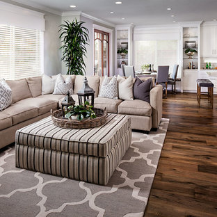 Inspiration for a beach style open concept medium tone wood floor living room remodel in San Diego with gray walls