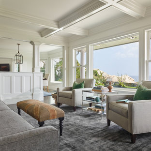 Example of a beach style dark wood floor, brown floor and coffered ceiling living room design in Boston with white walls