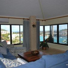 Tropical Living Room by Lagnappe Custom Interiors