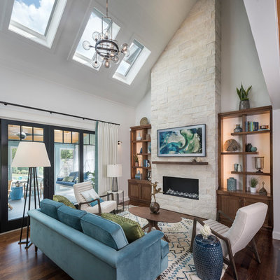 Inspiration for a contemporary open concept dark wood floor and brown floor living room remodel in San Diego with white walls, a ribbon fireplace and a stone fireplace