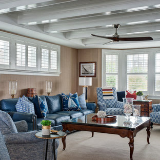 Inspiration for a beach style formal enclosed living room in Philadelphia with brown walls, medium hardwood floors, no fireplace, no tv, brown floor, exposed beam and wallpaper.