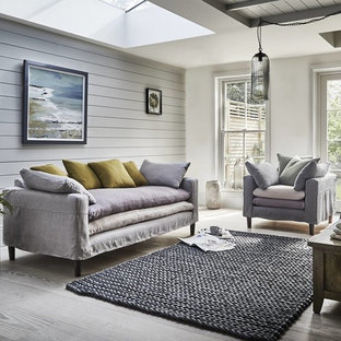 Photo of a nautical enclosed living room in Other with grey walls and grey floors.