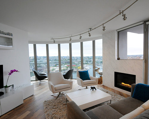 Inspiration For A Large Contemporary Open Concept Living Room Remodel In Vancouver With White Walls