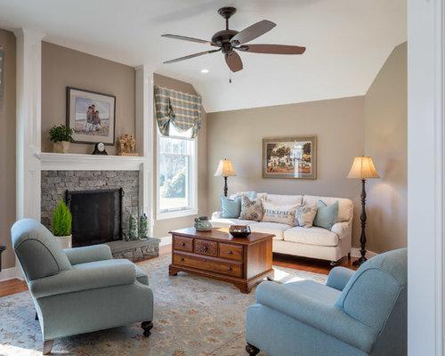 Mid Sized Elegant Enclosed Medium Tone Wood Floor And Brown Floor Living  Room Photo In