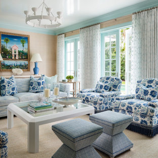 Inspiration for a world-inspired formal open plan living room in Miami with beige walls, carpet, no tv and beige floors.