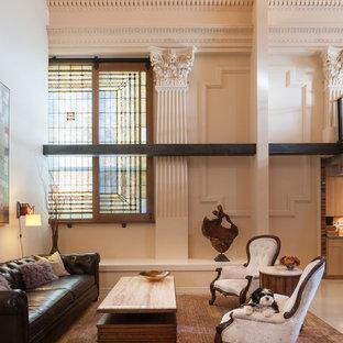 Immagine di un soggiorno classico di medie dimensioni con pavimento in cemento, nessuna TV, sala formale e pareti beige