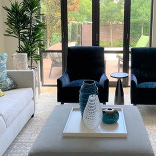 Ejemplo de salón para visitas abierto y ladrillo, moderno, grande, ladrillo, sin televisor, con paredes blancas, suelo de travertino, suelo beige y ladrillo