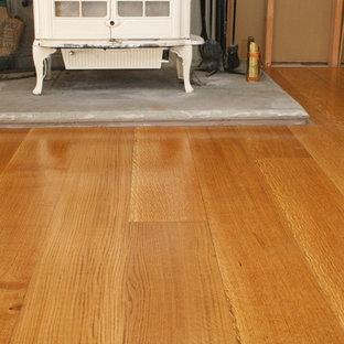 Example of a classic medium tone wood floor living room design in New York