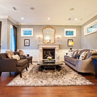 Photo of a large traditional enclosed living room in Vancouver with a music area, dark hardwood floors, a standard fireplace, grey walls, a stone fireplace surround, no tv and brown floor.