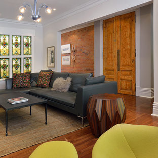 Inspiration for a large contemporary medium tone wood floor living room remodel in Toronto
