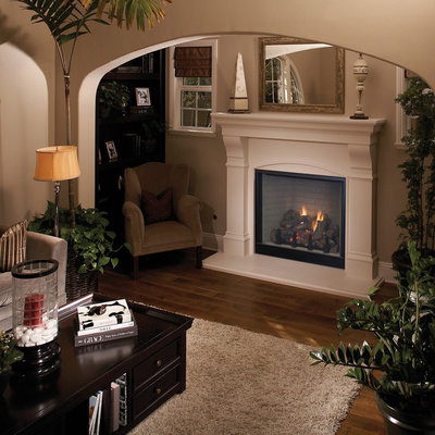 Example of a classic living room design in Orange County with a standard fireplace