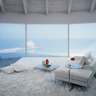 Immagine di un soggiorno moderno di medie dimensioni e aperto con sala formale, pareti bianche, pavimento in ardesia, nessun camino, nessuna TV e pavimento grigio