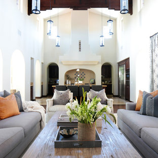 Huge tuscan formal and open concept dark wood floor living room photo in Orange County with white walls