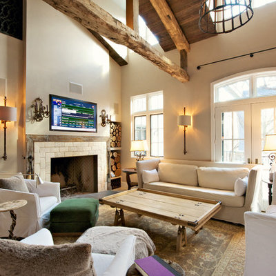 Inspiration for a farmhouse formal and open concept living room remodel in Philadelphia with beige walls, a standard fireplace and a wall-mounted tv