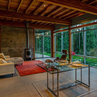 Inspiration for a mid-sized modern formal and open concept porcelain floor and gray floor living room remodel in Seattle with gray walls, a wood stove, a metal fireplace and no tv