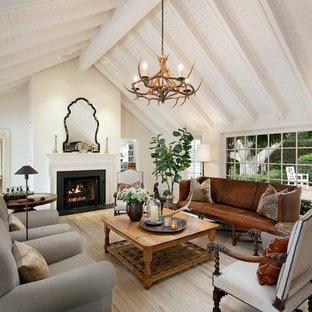 Inspiration for a country light wood floor and beige floor living room remodel in Santa Barbara with white walls and a standard fireplace