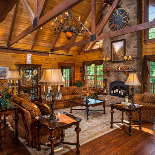 This is an example of a large rustic formal open plan living room in Columbus with brown walls, dark hardwood flooring and no tv.