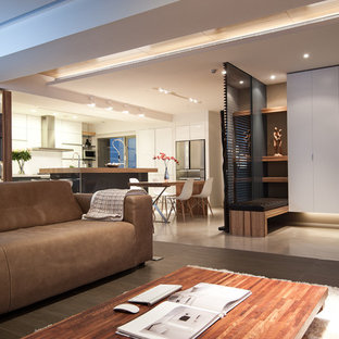 Inspiration for a contemporary open concept living room remodel in Other with gray walls