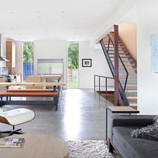 Immagine di un soggiorno moderno aperto con pavimento in cemento