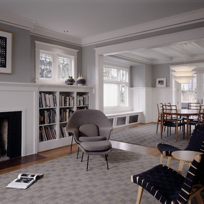 Mid-sized elegant formal medium tone wood floor living room photo in Seattle with gray walls, a standard fireplace and no tv