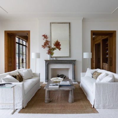 Inspiration for a transitional formal and enclosed medium tone wood floor living room remodel in Chicago with white walls, a standard fireplace, a stone fireplace and no tv