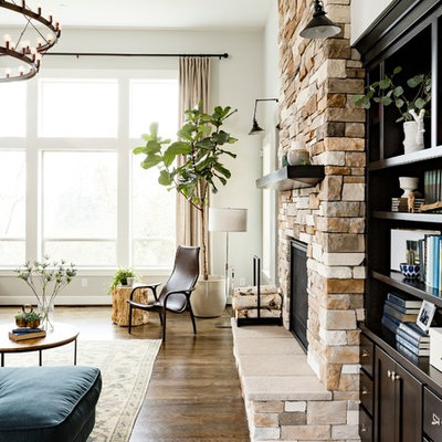 Living room - mid-sized transitional formal and open concept dark wood floor living room idea in Portland with white walls, a standard fireplace and a stone fireplace