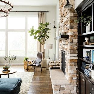 ポートランドの中サイズのトランジショナルスタイルのおしゃれなLDK (白い壁、濃色無垢フローリング、標準型暖炉、石材の暖炉まわり、フォーマル) の写真
