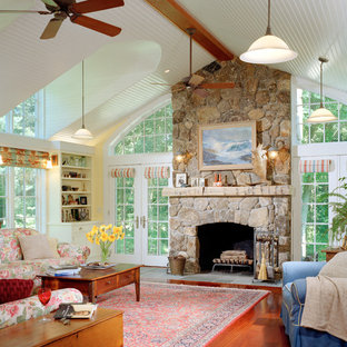 Elegant Living Room Photo In Boston With Yellow Walls, A Standard Fireplace  And A Stone