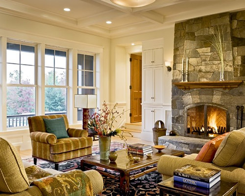 living room with stone fireplace. living room - victorian idea in burlington with a stone fireplace