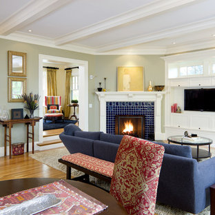 Photo of a victorian living room in Boston with a corner fireplace and a tiled fireplace surround.
