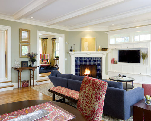 Victorian living room idea in Boston with a corner fireplace and a tile fireplace surround