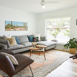Mid-sized mid-century modern open concept light wood floor and brown floor living room photo in Austin with white walls, no fireplace and a tv stand