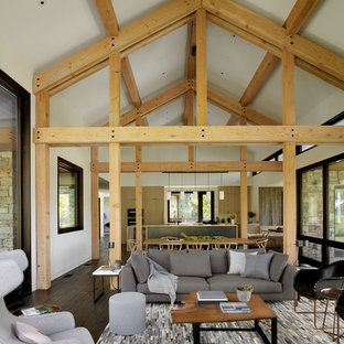 Mountain style open concept dark wood floor living room photo in Other with white walls