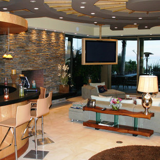 Inspiration for a large contemporary open plan living room in Orange County with a home bar, brown walls, ceramic flooring, a standard fireplace, a stone fireplace surround and a wall mounted tv.