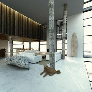 Immagine di un soggiorno design di medie dimensioni e aperto con sala formale, pareti bianche, pavimento in cemento, camino lineare Ribbon, cornice del camino in cemento, nessuna TV e pavimento bianco
