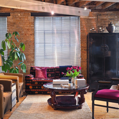Living room - mid-sized industrial open concept medium tone wood floor living room idea in London with multicolored walls