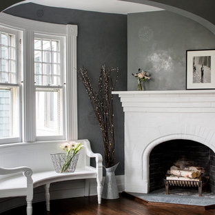 Inspiration for a victorian living room in Boston with grey walls, dark hardwood floors, a brick fireplace surround and a corner fireplace.