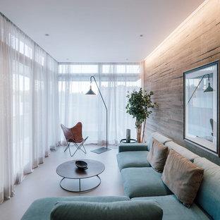 Foto de salón abierto, actual, de tamaño medio, con suelo de cemento, suelo gris y paredes grises